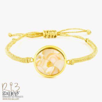 دستبند صدف طلایی با طرح پولکی