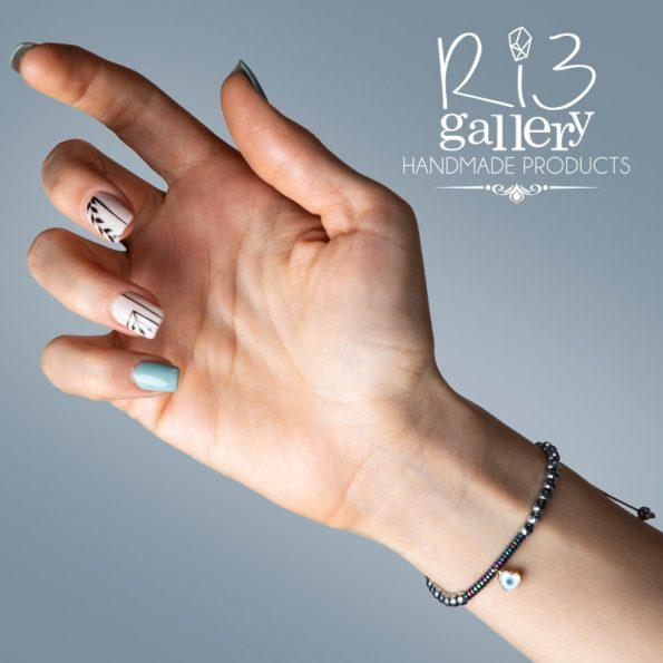 خرید دستبند طلا زنانه آویز چشم نظر ریسه گالری