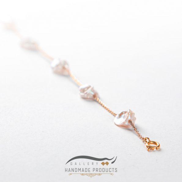 دستبند طلا زنانه مروارید زنجیری فروشگاه زیورآلات دست ساز ریسه گالری